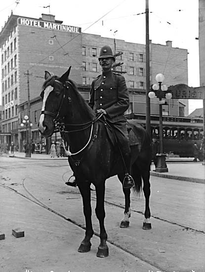 Mounted police constable at Davie and Granville Streets